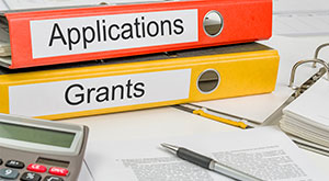 Postdoctoral Research Funding in Germany - An image of folders with the label applications and grant