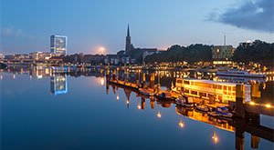 Image of reflection of Bremen skyline in the calm waters of river Weser, In Bremen, Germany