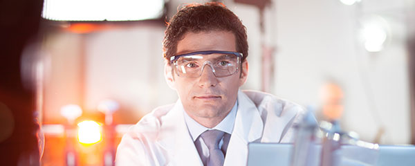 The PhD Application Process in Germany - Image of male scientist wearing protective eyewear in a lab