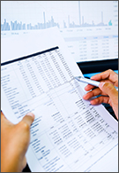 Accounting jobs - sheet of figures showing stock market analysis
