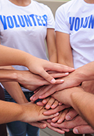 Fundraising jobs - volunteers with hands together
