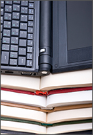 Information Management jobs - laptop resting on top of stack of books