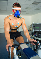 Sports jobs - male athlete performing ecg and vo2 test on indoor bicycle